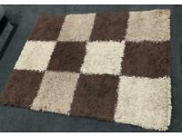 Brown and beige checked box rug