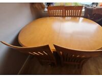 Extending dining table (plus chairs if wanted)