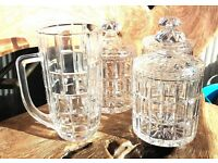 THREE GLASS CRYSTAL JARS AND MATCHING CRYSTAL JUG