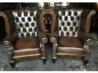 Pair of brown leather Chesterfield wingback armchairs