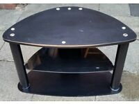 TV stand table, black wood top & bottom, black glass mid shelf. metal legs. In useable condition