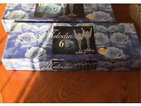 2 sets of crystal wine glasses