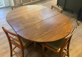 Extendable wooden dining table and four chairs