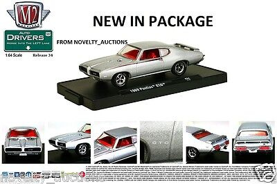 M44 11228 34 M2 MACHINES AUTO DRIVERS 1969 PONTIAC GTO GOAT  SILVER 1:64  JUDGE for sale  Shipping to Canada