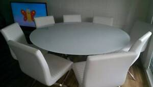 Round Glass Dining table with 8 white chairs Cronulla Sutherland Area Preview