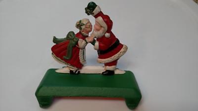 MIDWEST Santa Mrs Claus KISS Cast Iron Double CHRISTMAS STOCKING HOLDER Hanger A ()