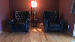 Two leather chairs.