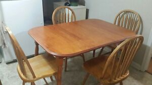 Dining table and four chairs..can deliver