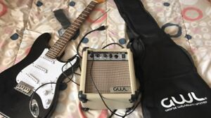 Electric guitar, amp, and case