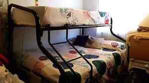 Black tubular bunks & ladder  ,mattresses & apparel Oak Flats Shellharbour Area Preview