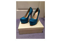 Brand New Blue women's size 4 heals