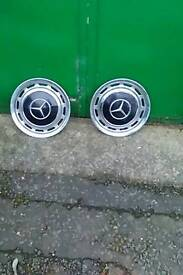 Two wheel trims off old mercedes steel