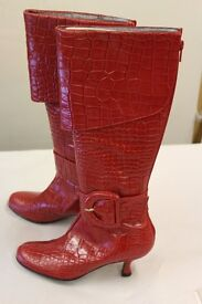 Brand new ladies designer red leather snake effect boots price tag £135.