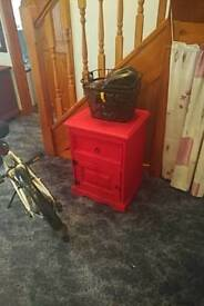 Red pink bedside table with draws