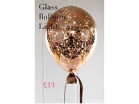 Hanging glass balloon light