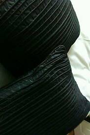 Two black satin pleated cushions as new