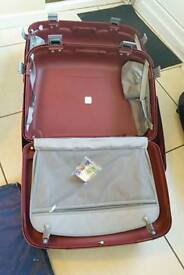 SUITCASES FOR SALE TWO RIGID PLASTIC REDOLZ SUITCASES ONE INSIDE THE OTHER