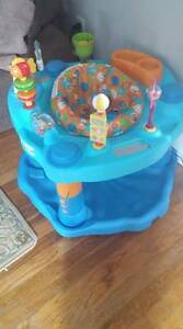 Breast pump and exersaucer