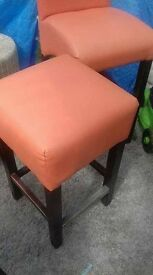 high back stools in orange