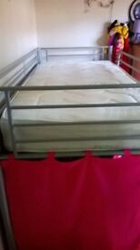 High Sleeper Kids single metal frame bed. Fab condition. Include pink curtains& materess if needed