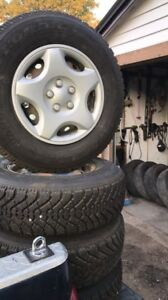P205/75/R14 snow tires and rims and 2 P195/60/R15 tires