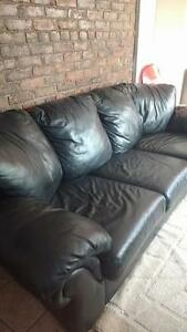Real black leather couch - great condition, clean home