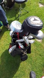 Full set lynx irons , 3 iron to pitching wedge Taylor Made driver, Dunlop 3 wood, ( Includes bag)