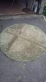 Dunelm round green rug