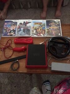 Wii mini with accessories and 4 games!