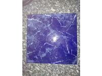 Large blue marble effect floor tiles.