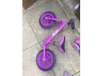 Purple balance bike