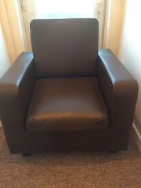 Faux brown leather armchair