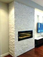 Looking to hire someone to build a stone veneer fireplace wall
