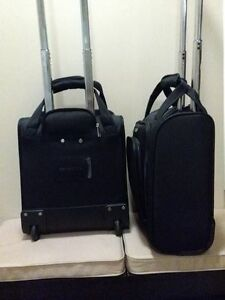 Two Universal Black Samsonite Carry-Ons