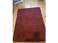 Red and black shaggy style rug
