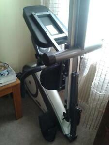 Row/bike exercise machine