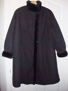 Ladies coat with faux fur lining and trim