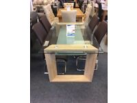 Glass top dinning table and chairs