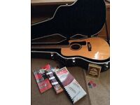 Washburn electro acoustic guitar with case and music books