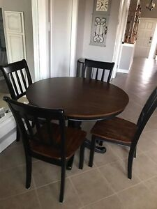 Table and chairs - by Ashley Furniture