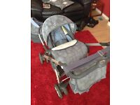 Silver cross travel system, including pushchair, car seat & changing bag.