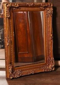 Ornate antique style framed mirror gold