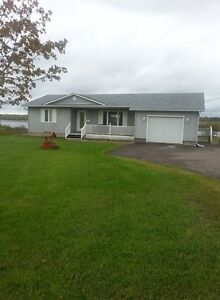NICE HOUSE FOR SALE BY THE RIVER IN GAUVREAU/PETIT TRACADIE, NB