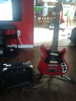 Kids size electric guitar and amp
