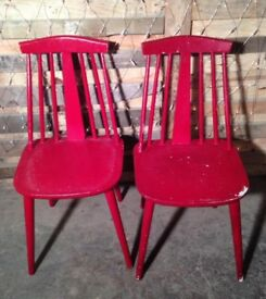 2 red chairs in need of repaint