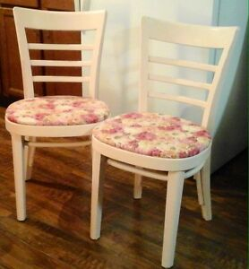 2 distressed wood chairs