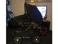 Black churchill pram with bag raincover and footmuff also recaro car seat with isofix