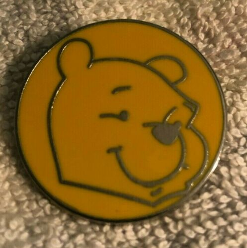 DISNEY TRADING PIN - WINNIE THE POOH HEAD SILVER OUTLINE ON A ORANGE ROUND PIN.