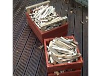 Two hand made wooden boxes full of dry kindlers