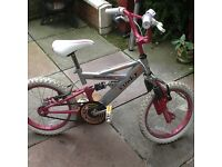 Girls bike 11inch in good condition used very little mountain ridge funky